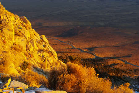 high sierra: Looking down to the valley from high Sierra Nevada mountain road just after sunrise, California