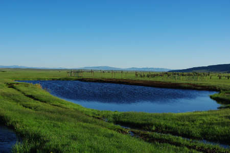 rand: Blue lake and green ranchland near Rand, Colorado