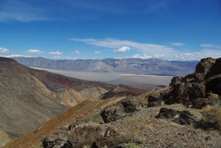 near death: Black rocks, valleys and snow mountains near Death Valley, California
