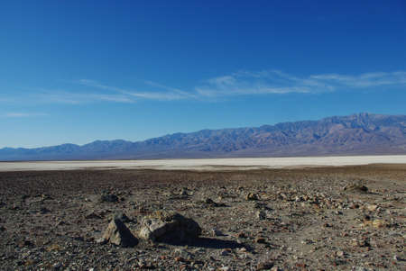 dispersed: Dispersed rocks, salt flats and high Panamint Range mountains, Death Valley, California Stock Photo