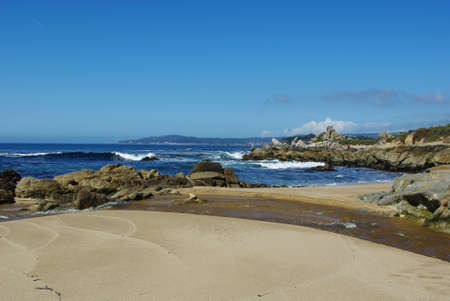 Creek, beach, rocks and waves, Pacific Ocean near Monterey, California Stock Photo - 12900845