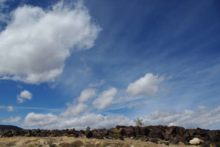 near death: Black rocks under beautiful cloudy skies near Death Valley, California Stock Photo
