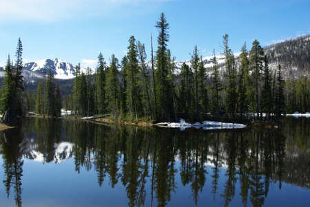 Lake with forest and mountains near Yellowstone National Park, Wyoming Stock Photo