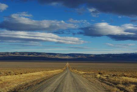 Dirt road through Nevada Stock Photo - 12900769