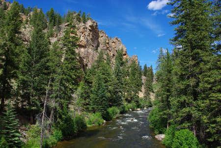 River, forest, rocks and blue sky, Colorado