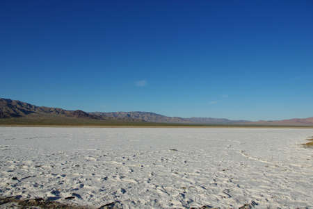dispersed: Wide salt flats and dispersed mountain chains in the desert, California