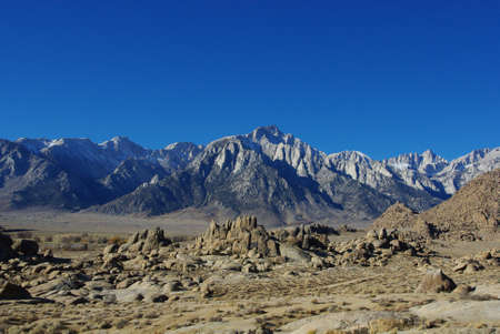 Alabama Hills and Sierra Nevada under blue sky, California photo