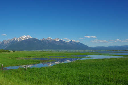 Mission Mountains reflected on wetlands south of Flathead Lake, Montana Stock Photo - 12963862