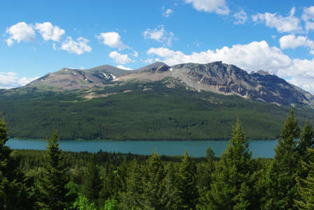 Vast forests, lake and high Rockies, Glacier National Park, Montana Stock Photo - 13042344