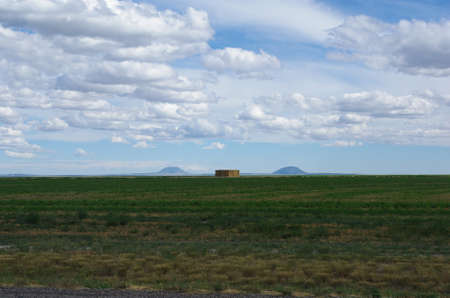 Prairie, hay and dispersed mountains, Idaho Stock Photo - 13099027