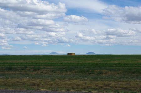 Prairie, hay and dispersed mountains, Idaho Stock Photo - 13099027