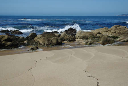 Beach, rocks and waves near Monterey, California photo