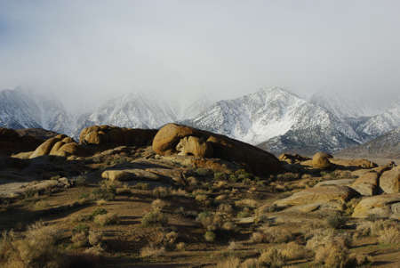 Sun on rocks and fog on Sierra Nevada, California photo