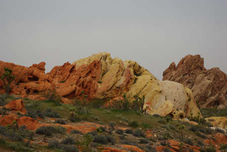 Colourful rocks under gray skies, Nevada Stock Photo - 13309318