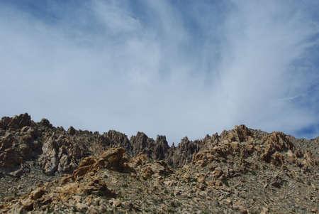 Rugged rock mountains under interesting skies, Nevada Stock Photo - 13553131