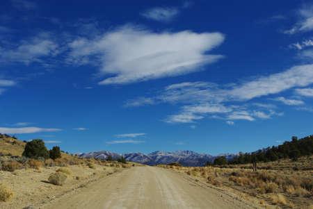 Jeep road towards snowy mountains, Nevada