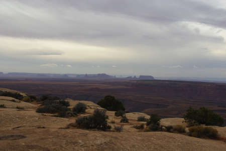 monument valley view: Distant view of Monument Valley from Muley Point on a cloudy day, Utah