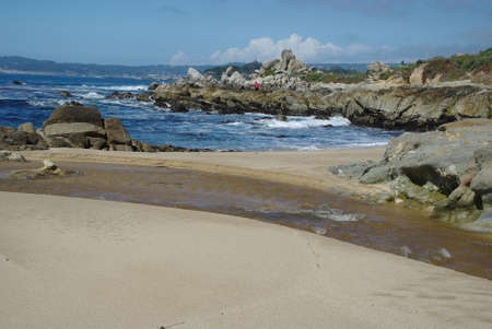 Rocks, beach, and Pacific Ocean, California Stock Photo - 13641733
