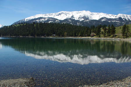 Snow mountain reflection on clear waters of Wallowa Lake, Oregon Stock Photo