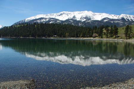 Snow mountain reflection on clear waters of Wallowa Lake, Oregon Stock Photo