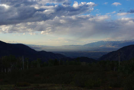 View of Utah Lake and Salt Lake City in the distance from Mt Nebo Wilderness in the evening, Utah photo