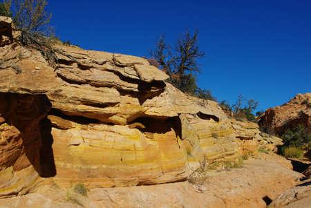 escalante: Yellow rocks under blue sky Stock Photo