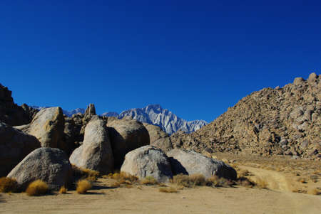 Round rocks and Sierra Nevada under blue sky photo