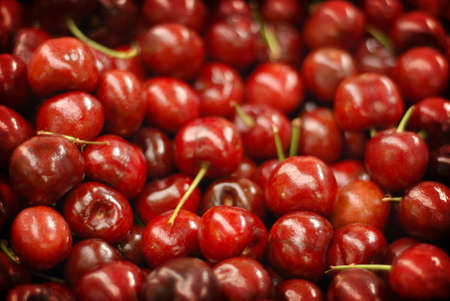 This photo was taken by me on the market in Sao Paulo  These fruits are red cherries and sweet  photo