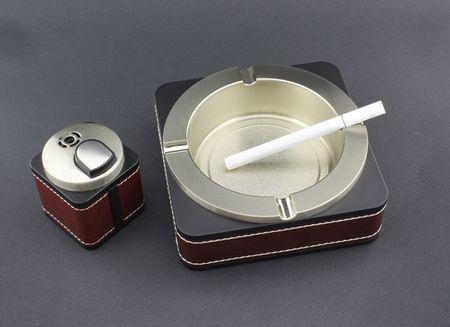 lighter: Cigarette in ashtray and lighter