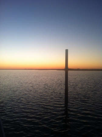 topsail: Sunset off of a dock at topsail island