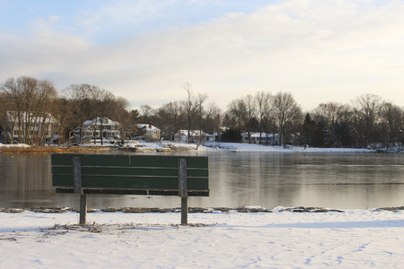 Bench overlooking frozen lake