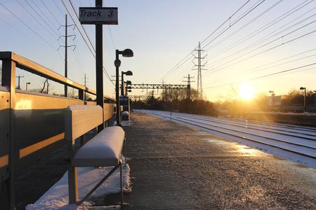 suburban train station at sunrise
