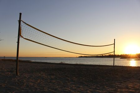 volleyball net: beach volleyball net at sunset Stock Photo