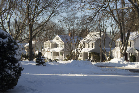 suburban homes the day after a snowfall