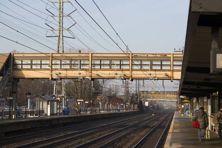 footbridge over suburban rail station Фото со стока