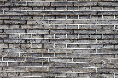 Background of grey brick wall texture photo