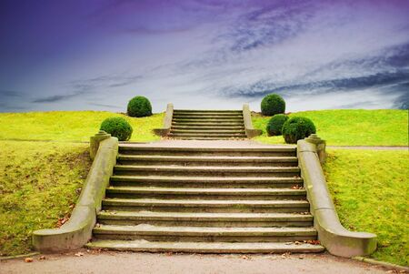 a stone stairway in anture with blue sky photo