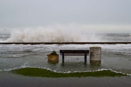 Storm surge with a seat to view photo