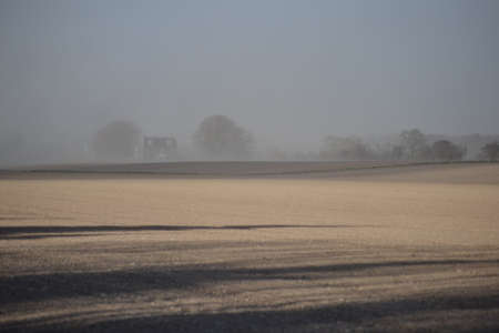 ploughed field: Dust storm and sunshine