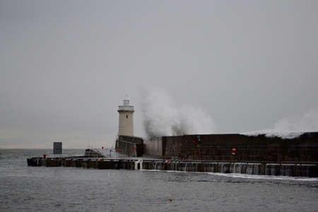 swell: Buckie harbour during a big swell Stock Photo