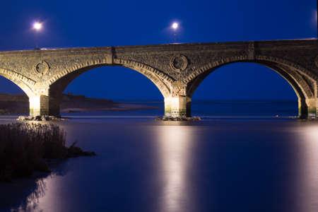 stonework: Illuminated old stonework bridge over the Deveron