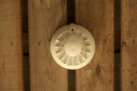 detectors: Smoke detector on wooden background Stock Photo