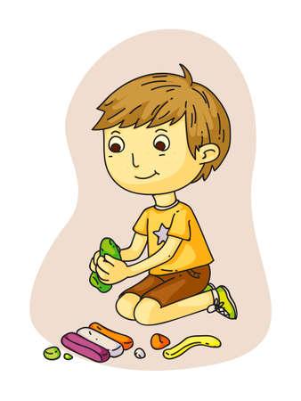 Cute smiling little boy making plasticine figures