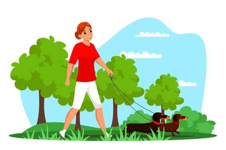 Pet owner walking dog on leash outdoor in park