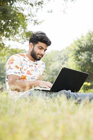 college boy work on laptop