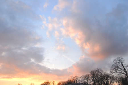 Rapturous sunset cloudy sky, with beautiful pastel shades and dramatic cumulo nimbus clouds. Copy space.
