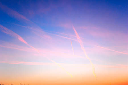 Spectacular sunset sky with vapour trails and high clouds. Big open sky with natural blues, pinks, cyan and deep yellows. Copy space. Stock fotó - 120848461