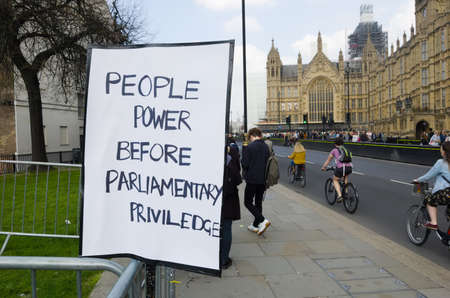 Westminster, London, March 30th, 2019: A misspelt pro brexit banner is pinned to the fence opposite Westminster, claiming that parliamentary privilege is being used innapropriately.