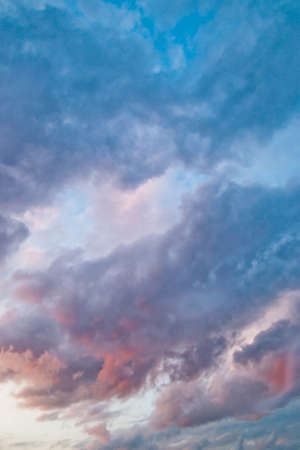 England, summer 2010: Beautiful colorful cloud formations picked out by the setting sun. Background, copy space.