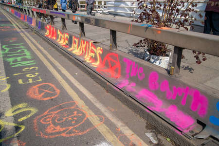 WATERLOO BRIDGE, LONDON, APRIL 19th, 2019: Artwork by Extinction Rebellion supporters expresses concern about global climate change on 19th April 2019.
